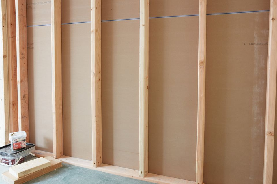 Drywall and wooden support beans exposed during home renovation