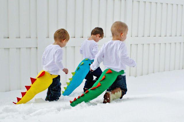 Children running with dinosaur tails