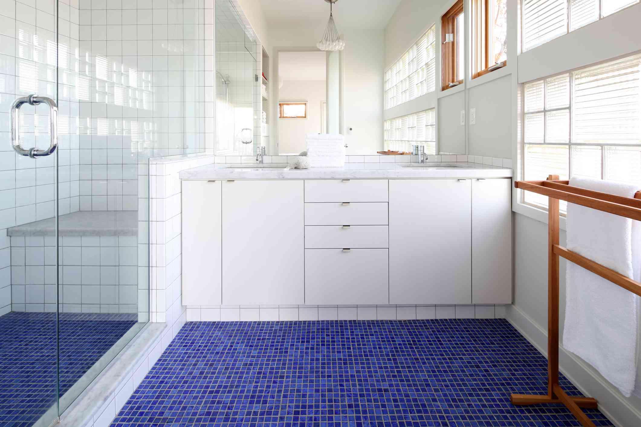 Blue mosaic tile bathroom floor