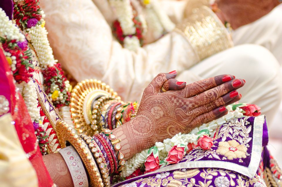 Indian bride with henna design on hands