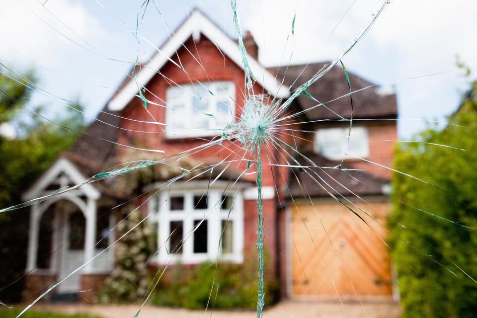 Residential house seen through shattered glass
