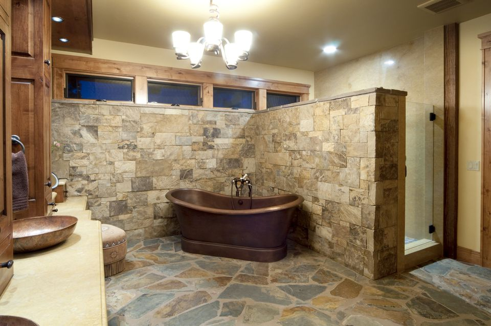 A bathroom with brick paver flooring