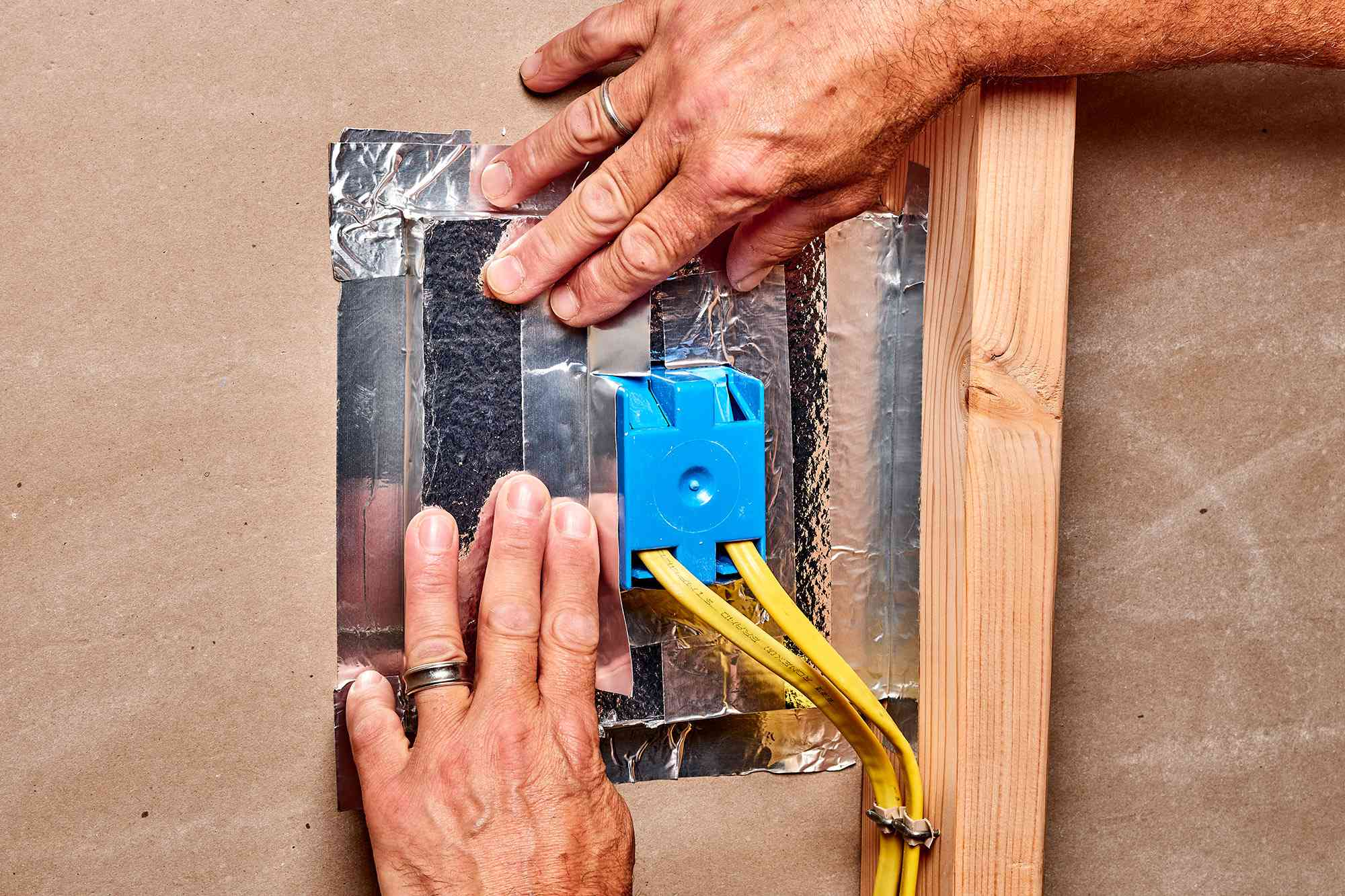 Rigid foam insulation covering all sides of electrical box
