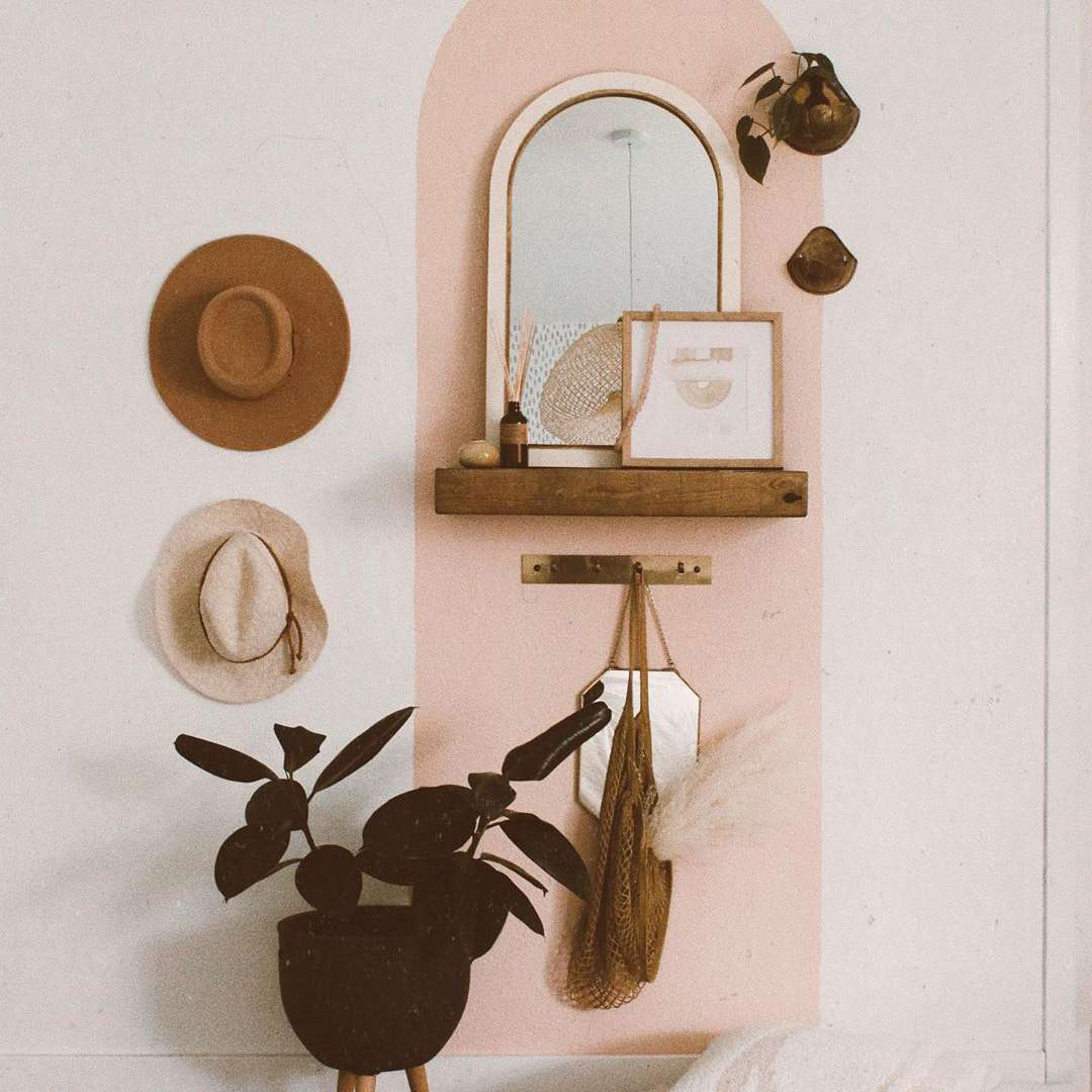 Wall with pink paint and hats