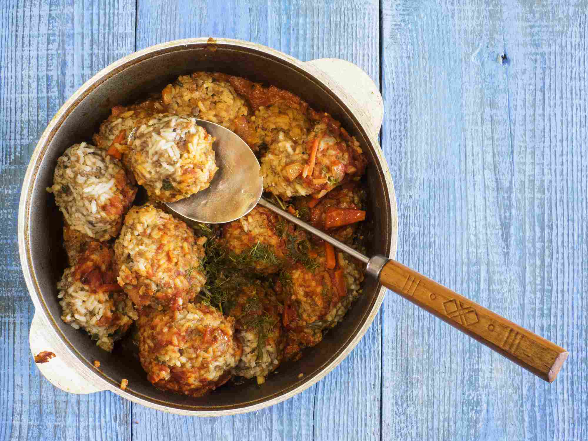Meatballs in tomato sauce in saucepan
