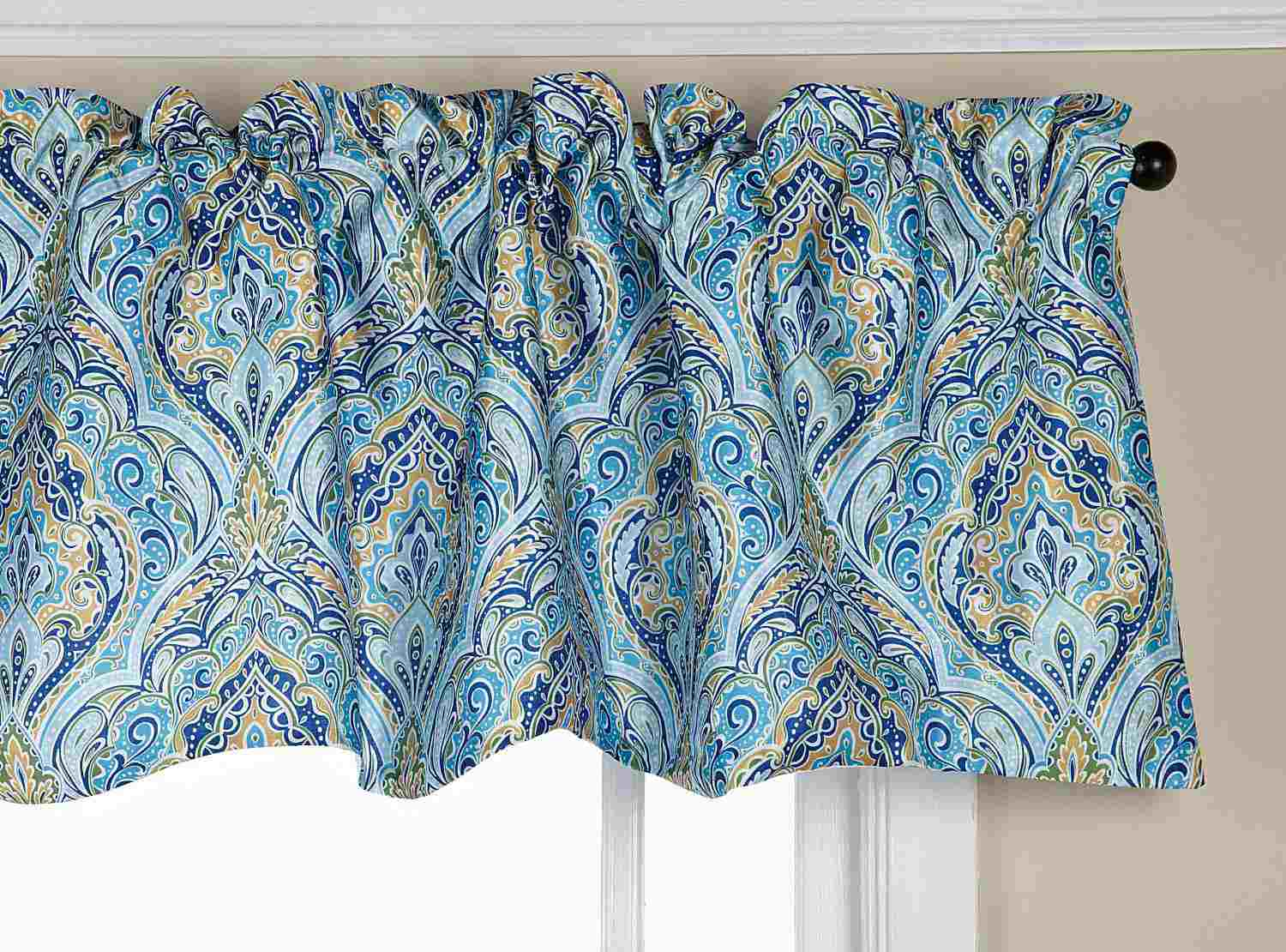 Blue paisley window valance mounted on window.