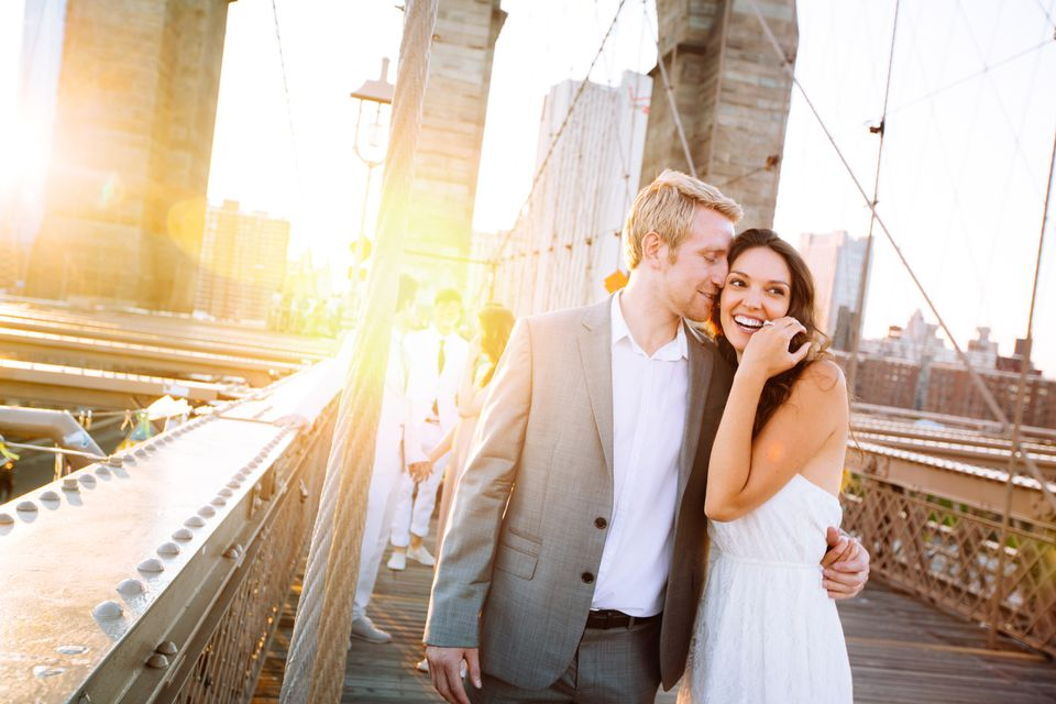 Happy couple on Brooklyn Bridge