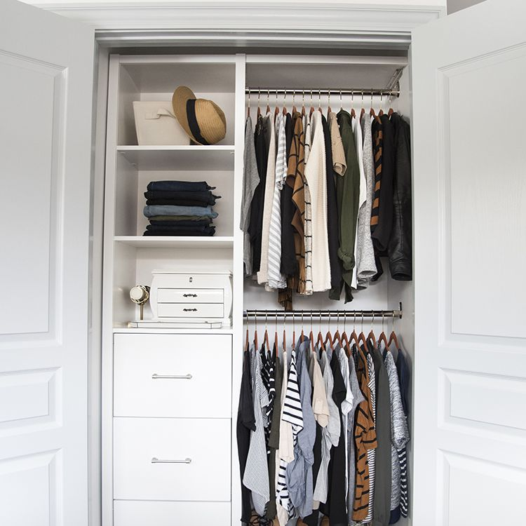Small closet with drawers and clothing bars