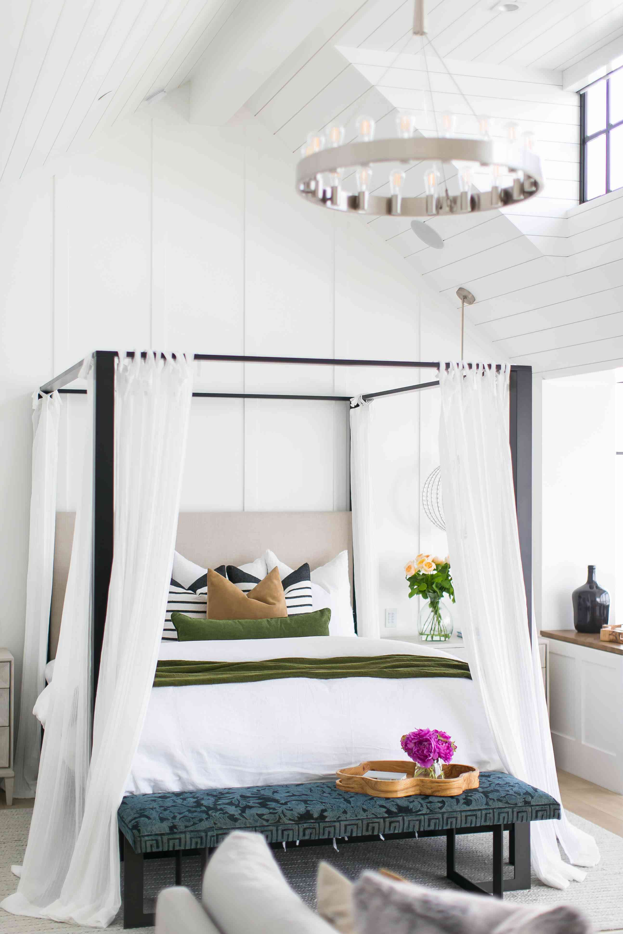 light and airy canopy bed with white curtains