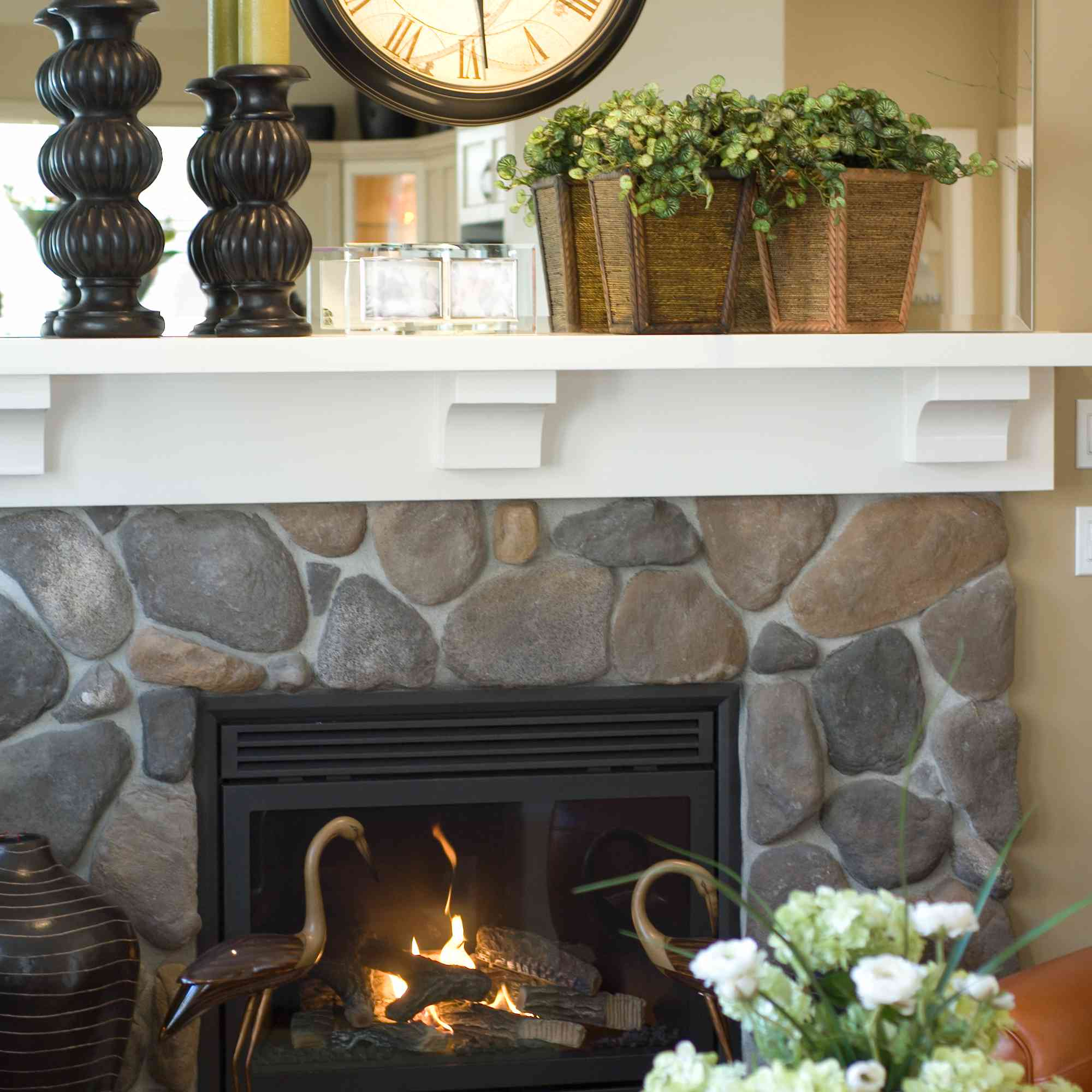 Mantel decor with clock and accessories