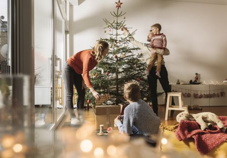 family decorating christmas tree - Christmas Decoration Store