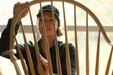 Anne of All Trades working on a wood chair, feature for Girls Who Build
