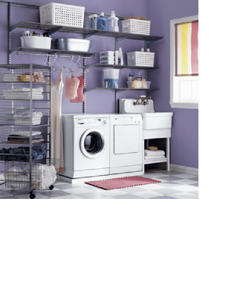 Washer and dryer next to washing sink in laundry room painted in a purple color.