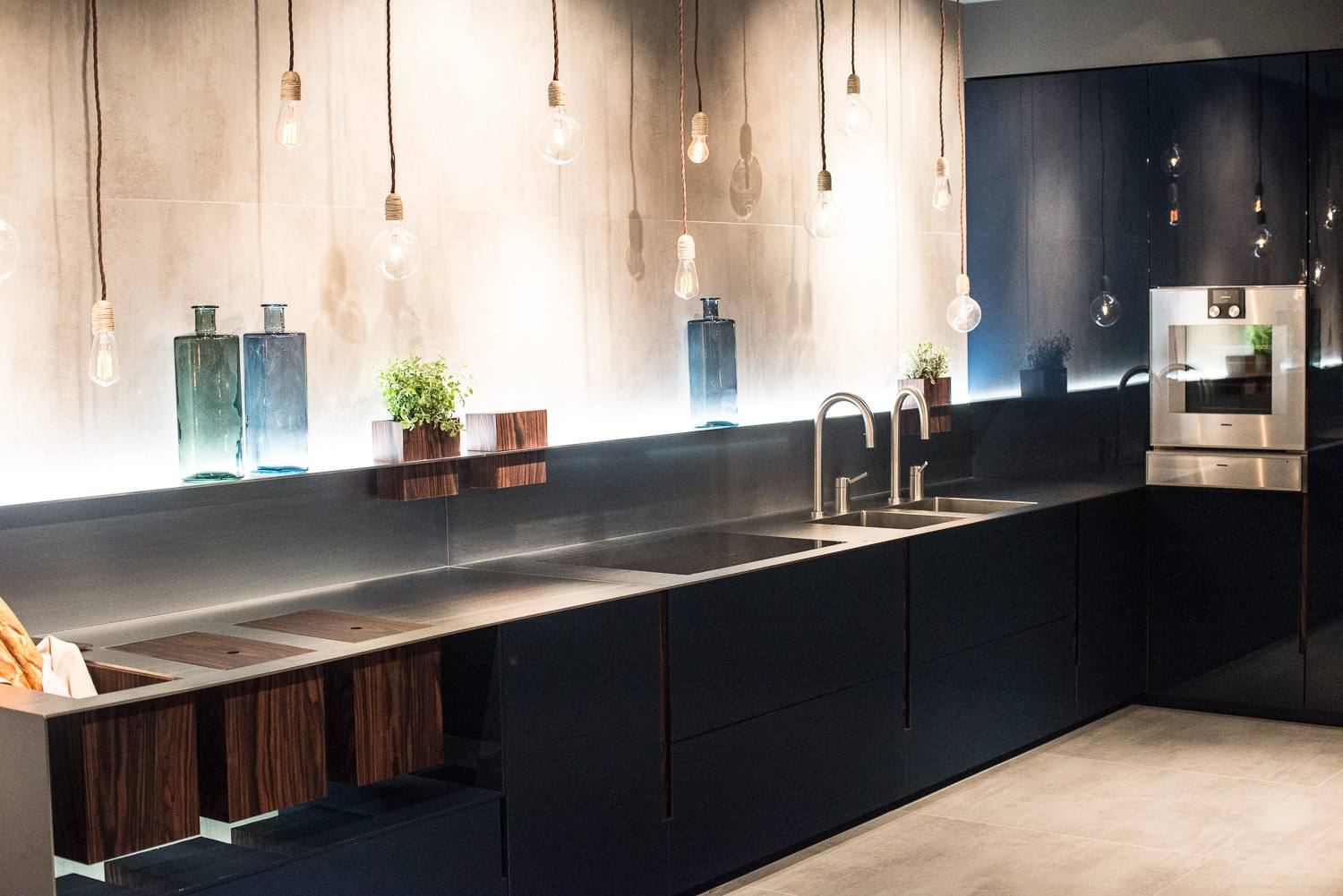 Light bulbs hanging in modern kitchen