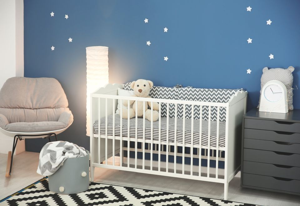 Baby room interior with comfortable crib and rocking chair
