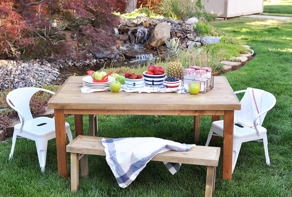 A kids picnic table in a yard