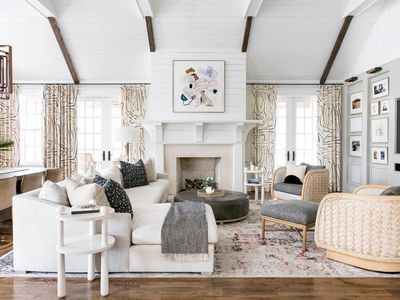 living room with high beams and white color palette