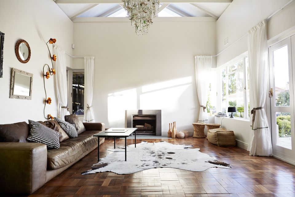 living room with white walls and brown sofa