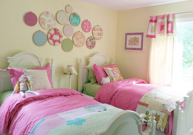 Embroidery hoop art wall display in girl's room