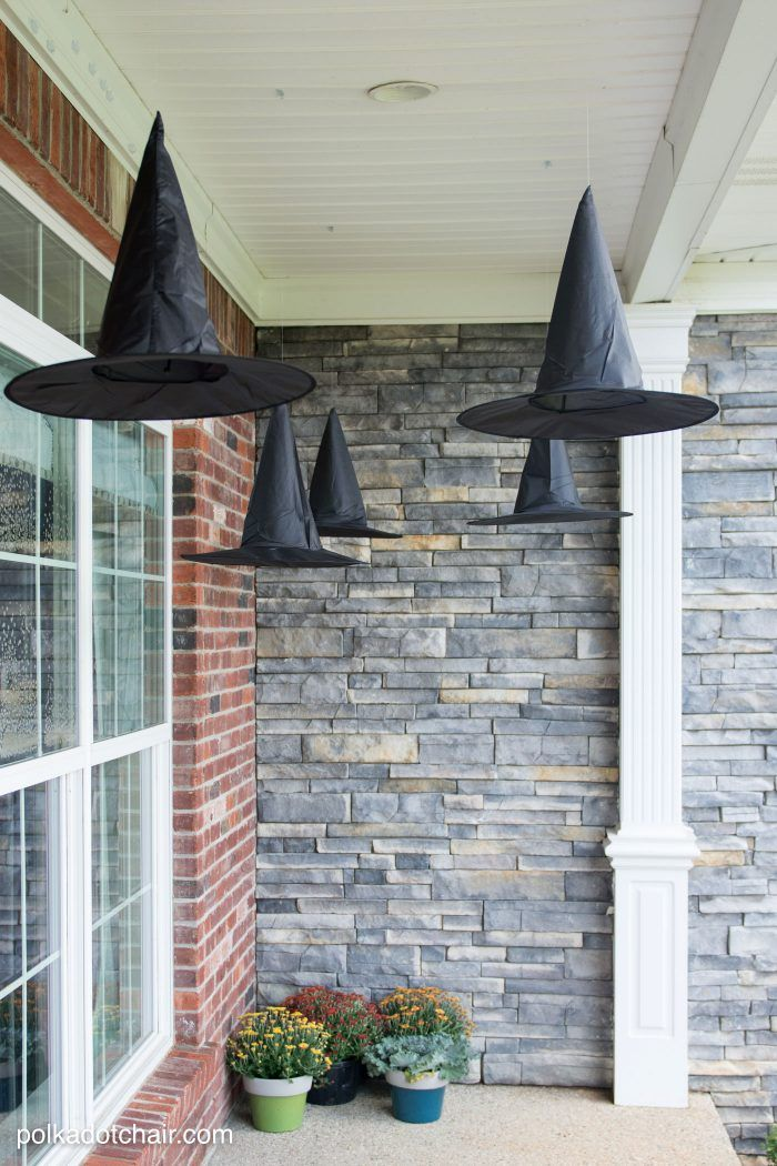 Witch hats hung from a porch