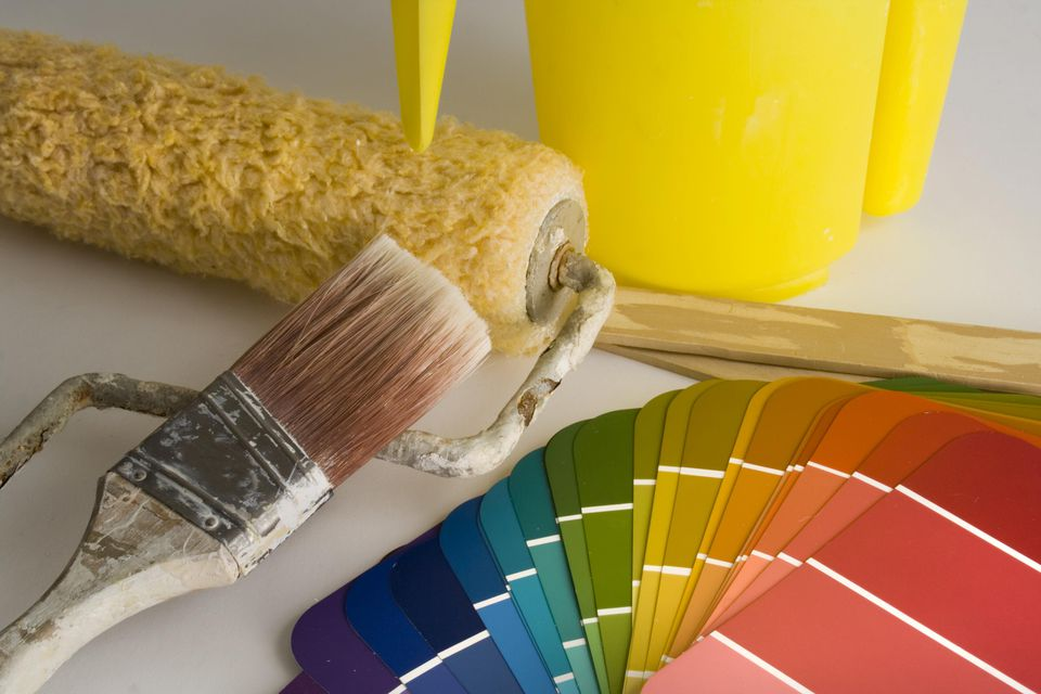 Paint color samples and other house painting tools are ready for a maintenance project