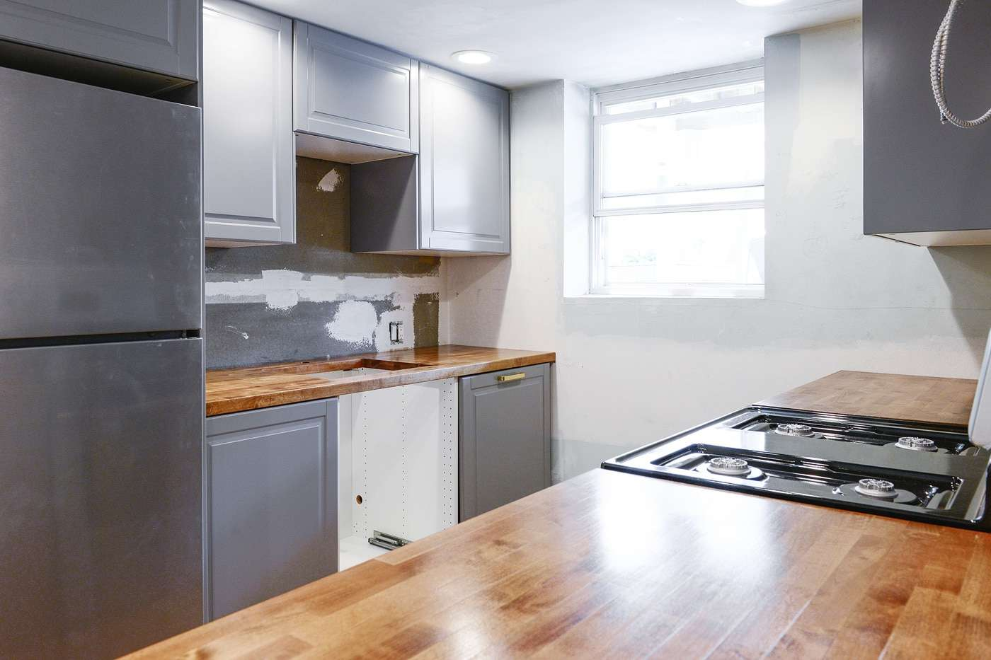A kitchen reno with wood countertops