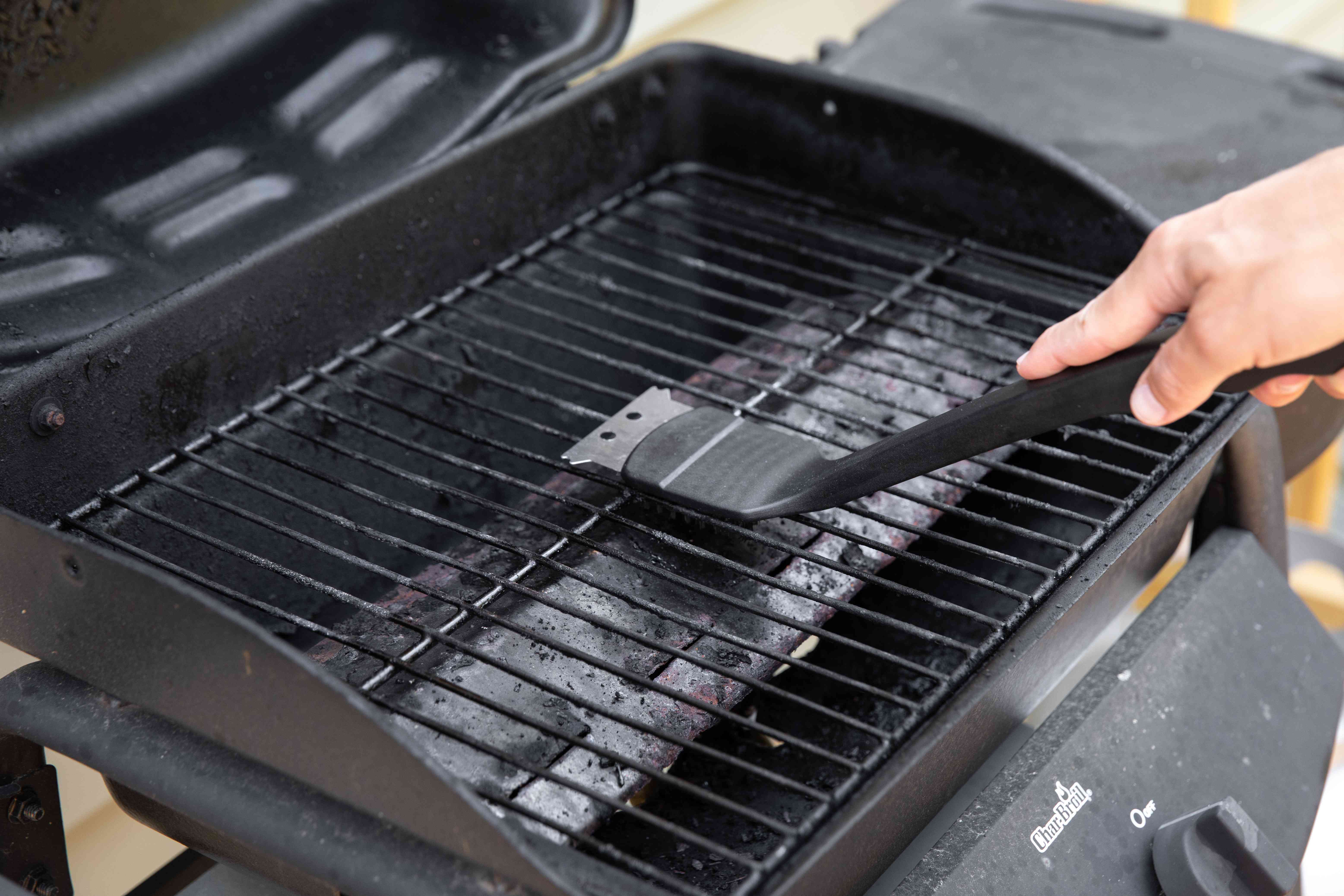 scraping off grill grates