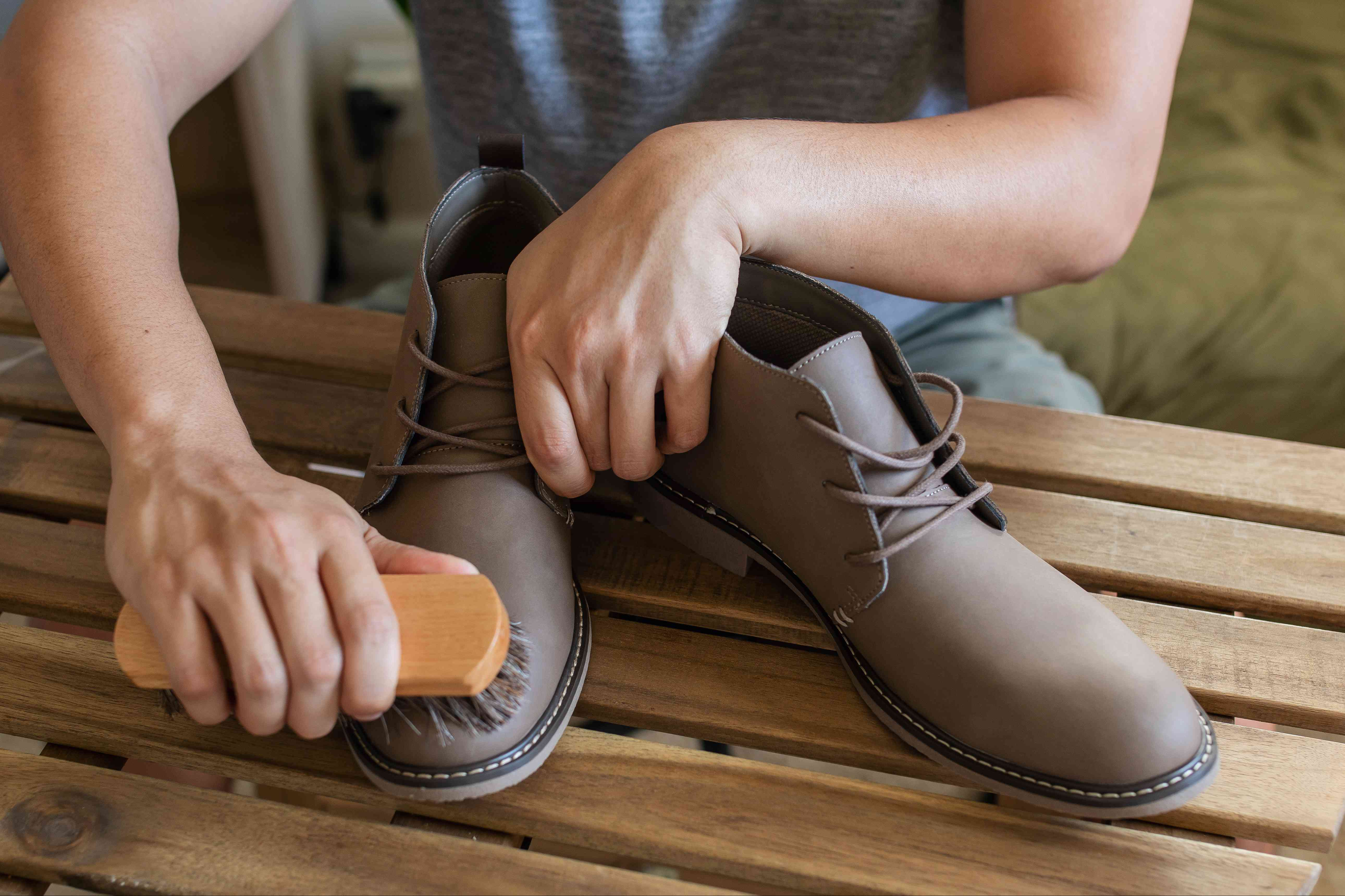 person cleaning a nubuck shoes