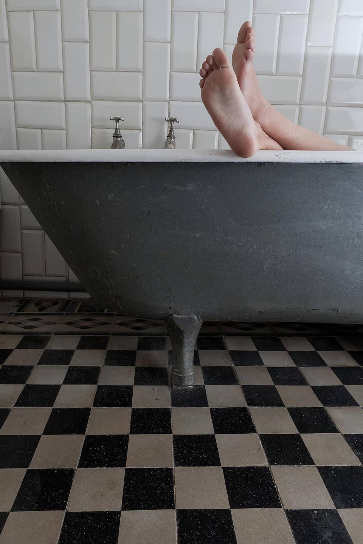 feet up in a retro bathroom