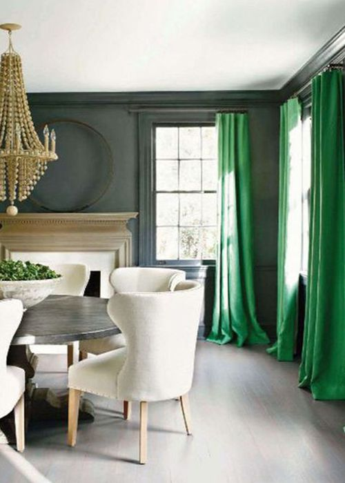 Formal dining room with drapes in Pantone Greenery
