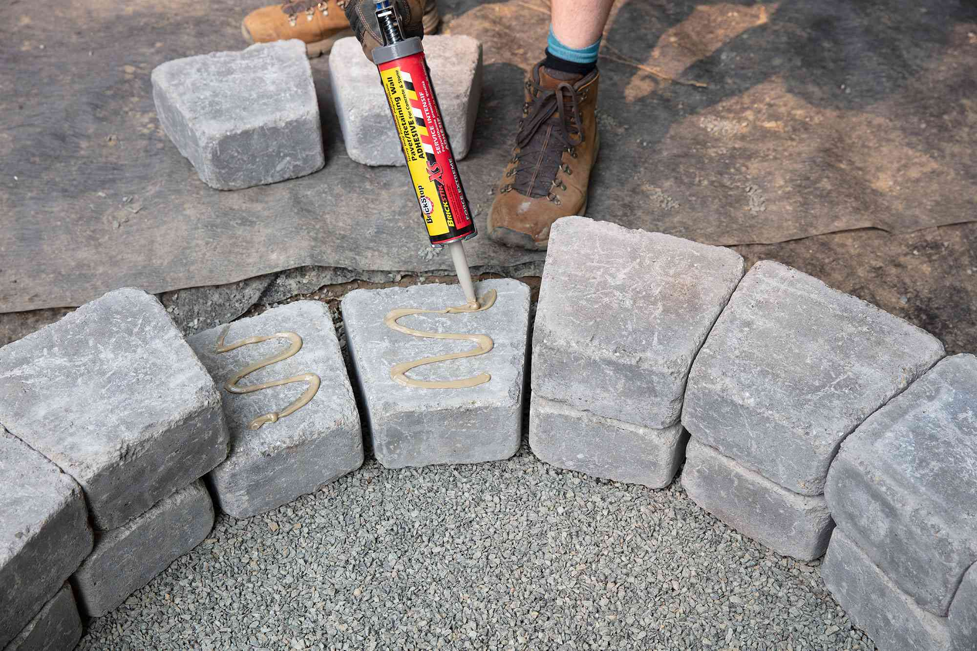 Two blocks glued with landscape adhesive for fire pit