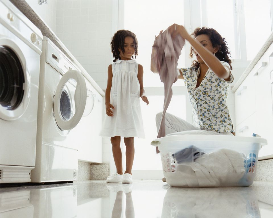 a mom and daughter doing laundry