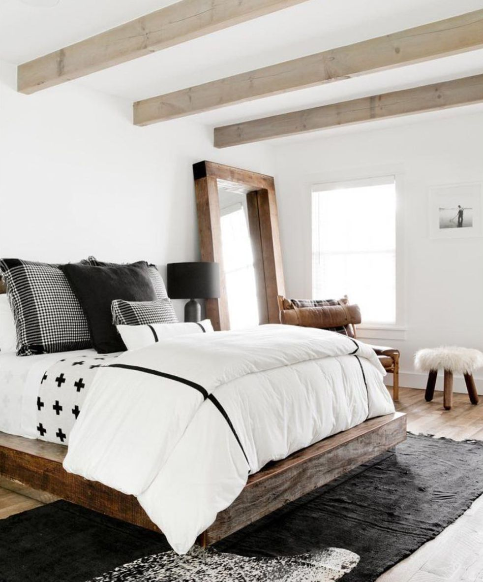 bedroom with beams and layered bedding