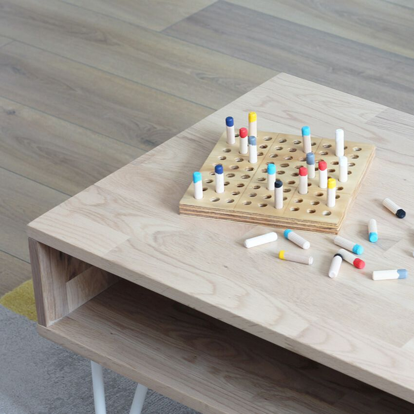 A wooden game on a table