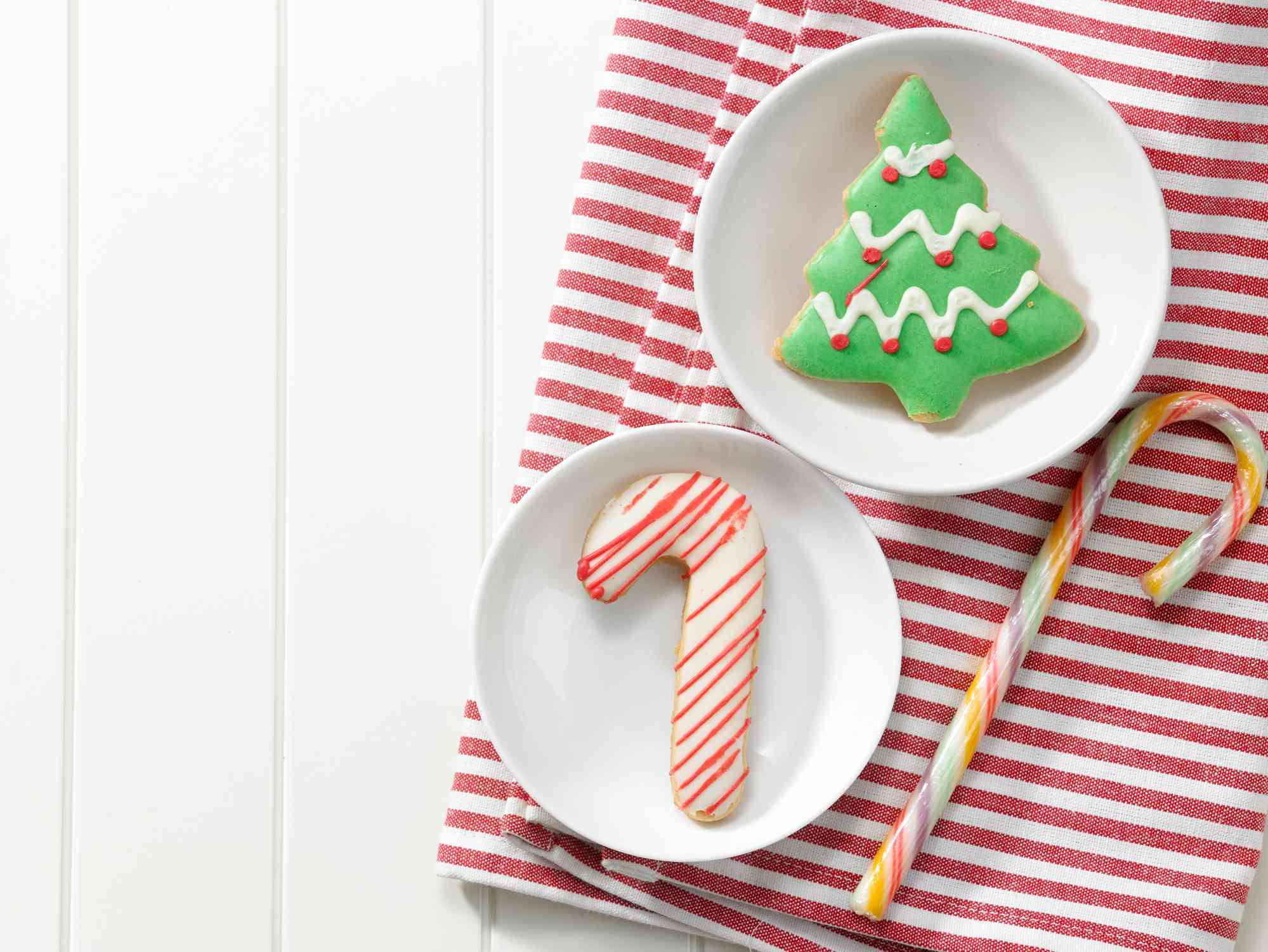 Directly Above Shot Of Cookies And Candy Cane With Napkin On Table