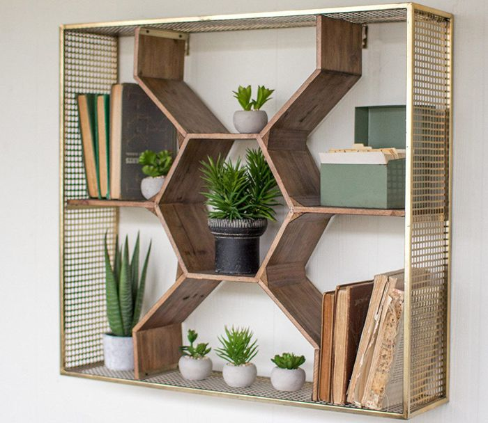 geometric shelf unit with succulents and books