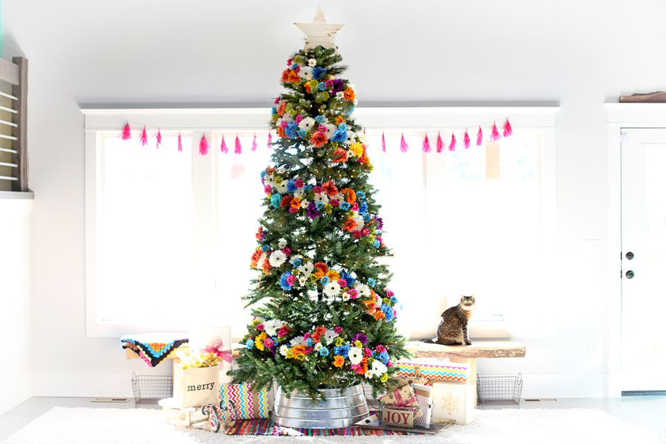 Christmas tree covered in colorful flowers.