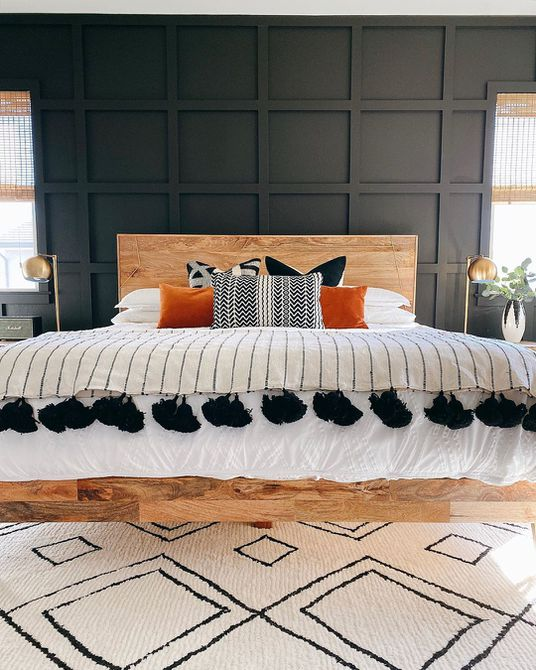 Bedroom with black accent wall