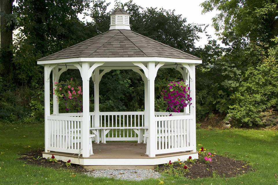 White gazebo with hanging plants