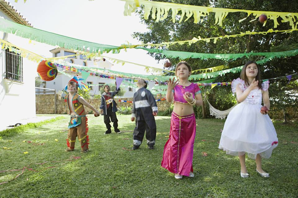 Children in costume at birthday party