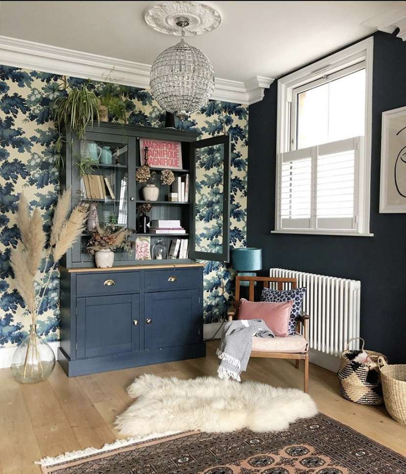 Patterned wallpaper in a blue-toned room