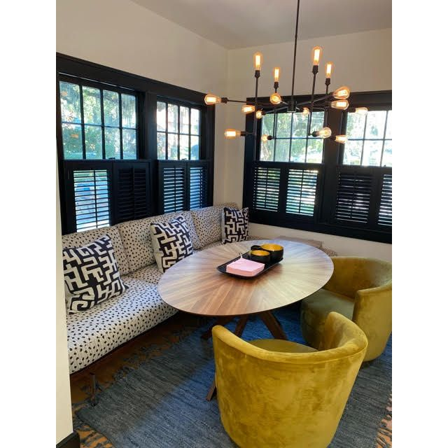 Dining room with black, white, and yellow color scheme by Fitz Pullins