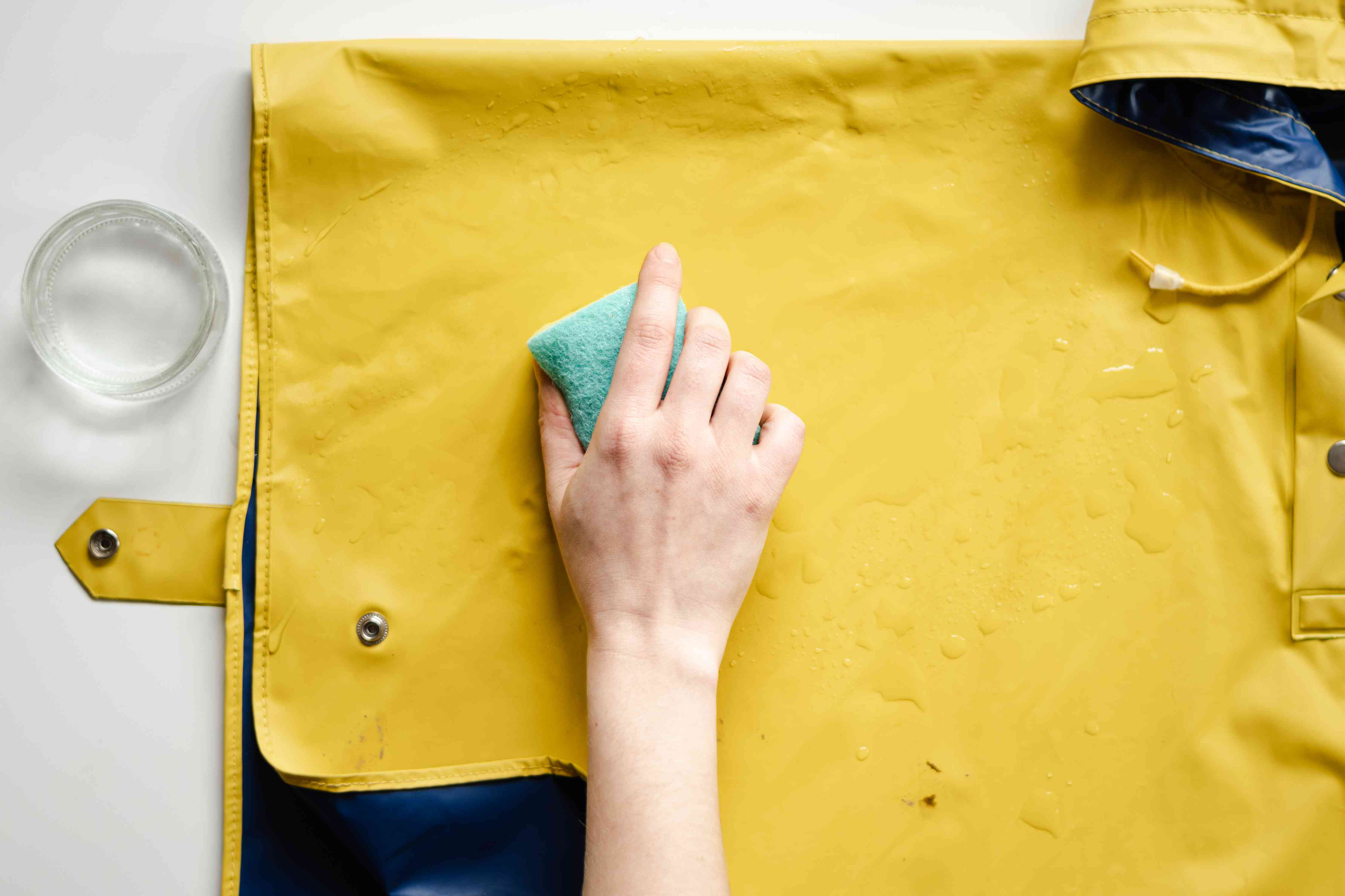 wiping a vinyl jacket with a sponge