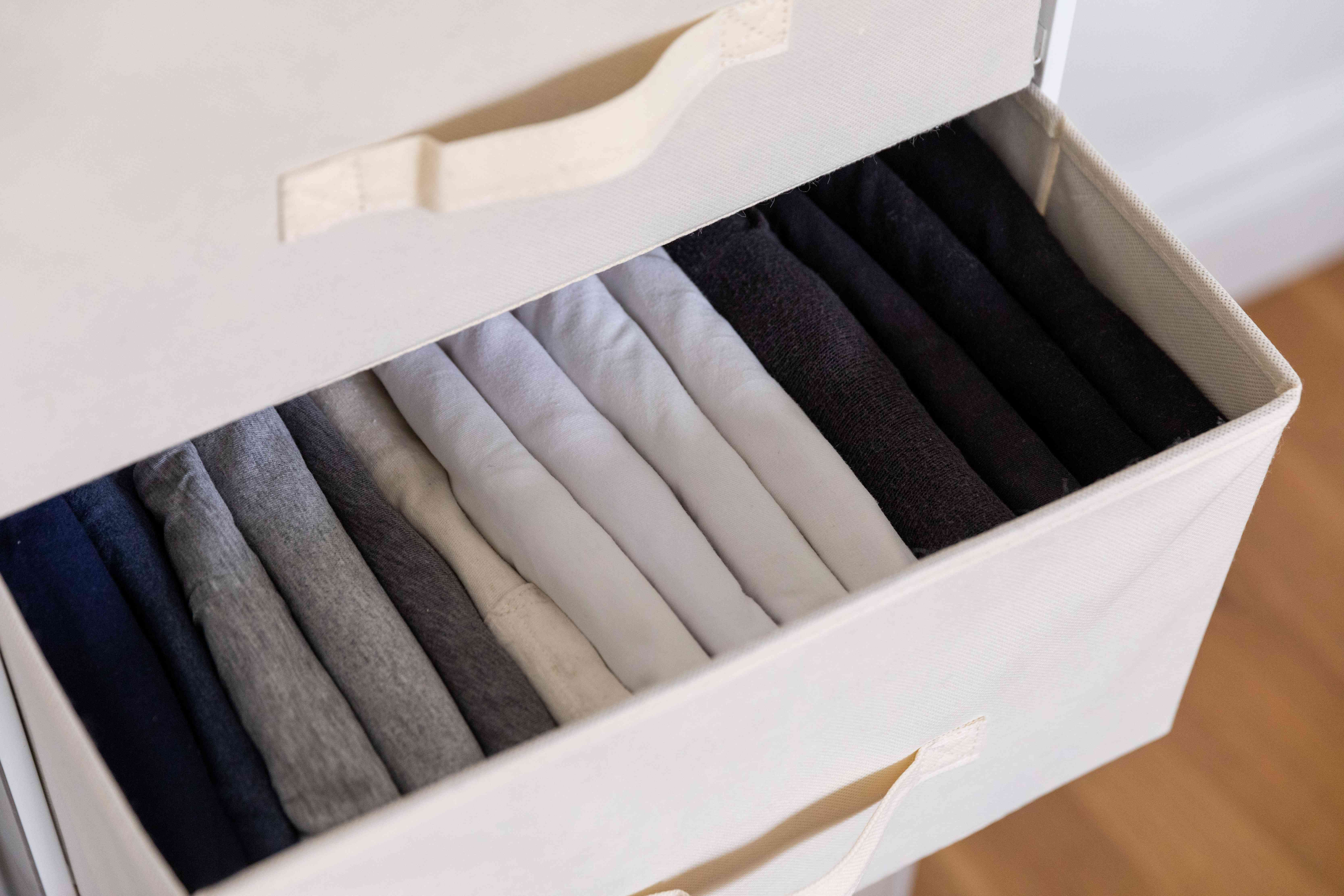 tshirts neatly folded in a drawer