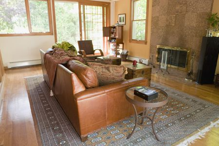 Leather Sofa Chair In Front Of Living Room Fireplace
