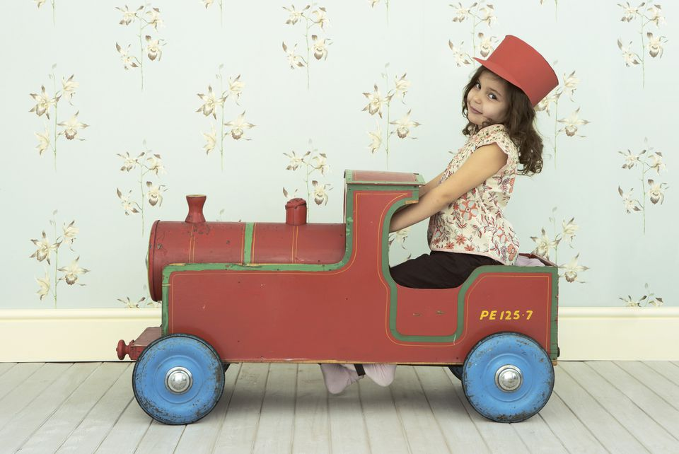 Little girl sitting in a Toy Train