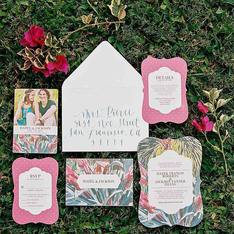 A wedding invitation suite in the grass.