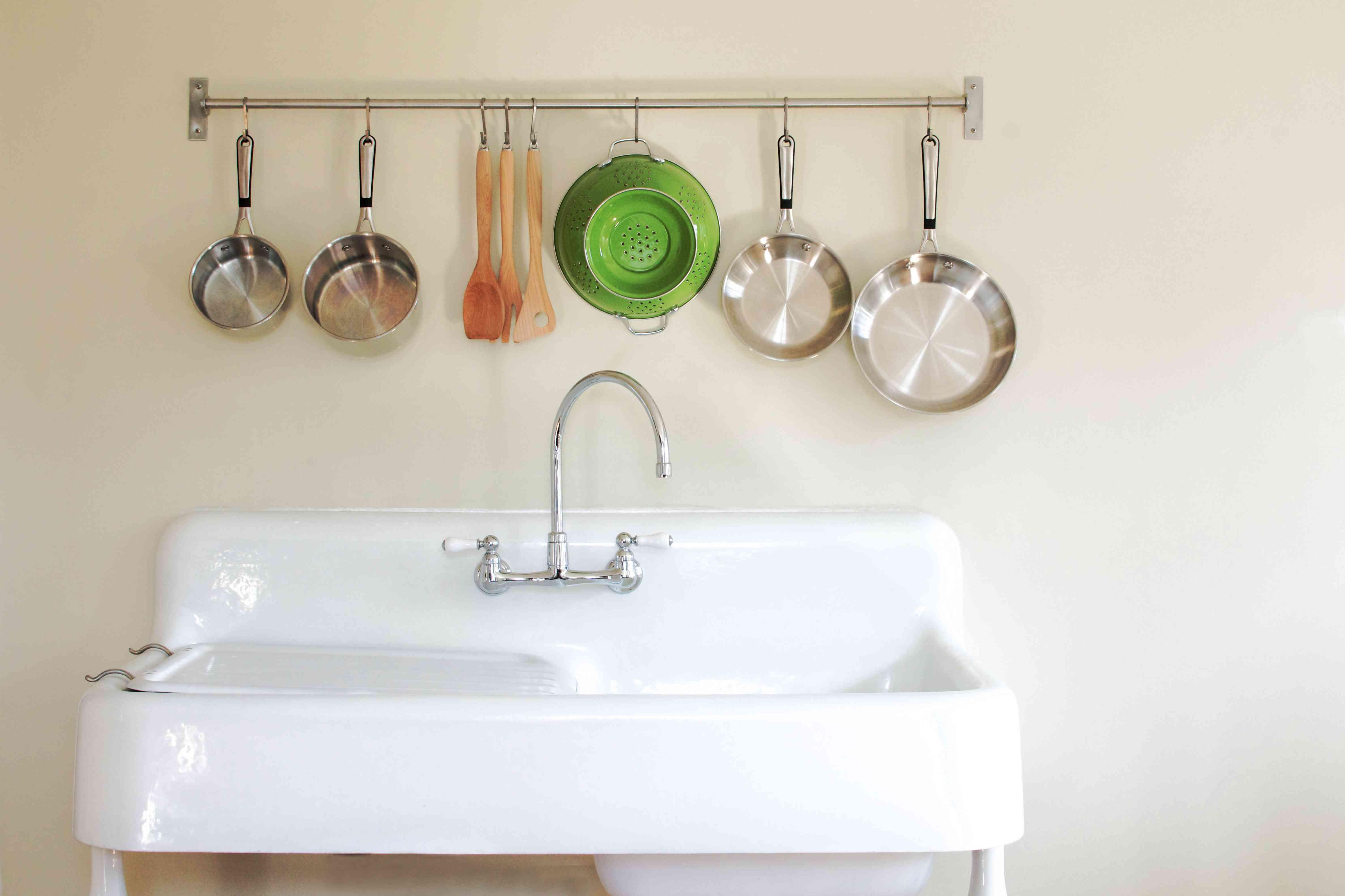 Antique kitchen farm sink with hanging pots