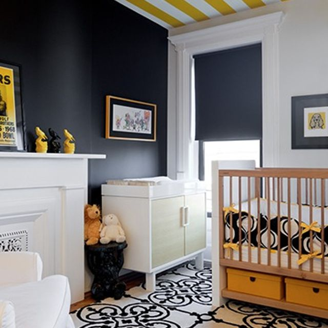 Rich navy nursery with sunny yellow accent and striped ceiling