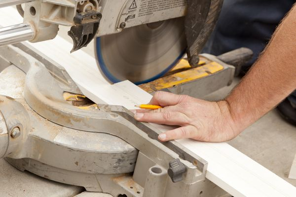 Contractor cutting baseboard